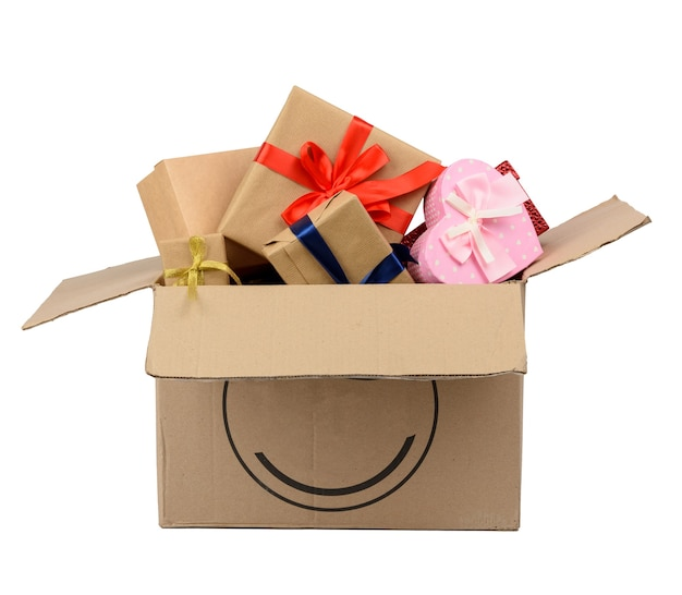 Piled in a brown large box a pile of various wrapped gifts isolated on white background