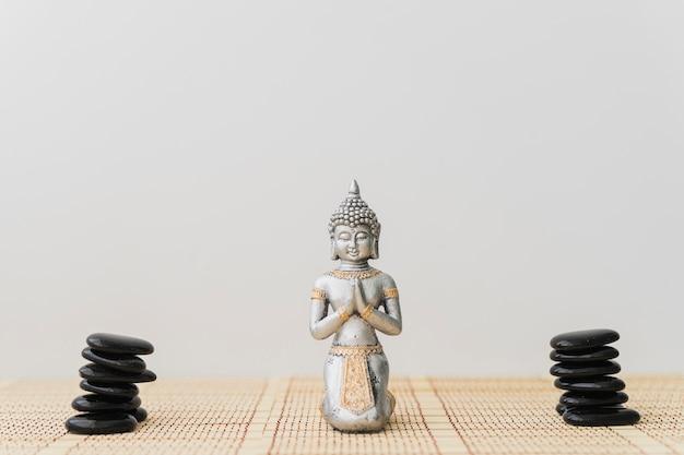 Piles of black stones and buddha