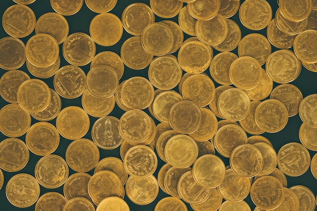 Piles of coins on black background, business and financial concept.