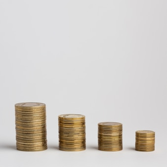 Piles of coins with plain background