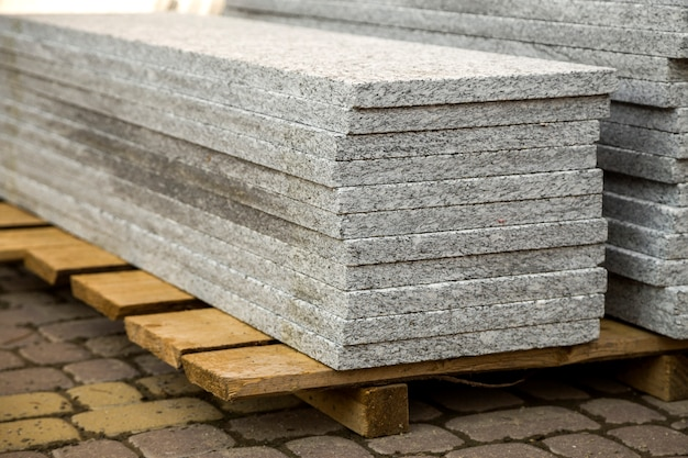 Piles of granite marble slabs.  stone sheets for decorative construction.