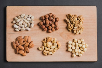Piles of nuts on wooden board