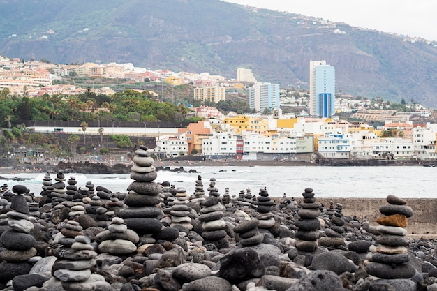 Piles of rocks with city on background
