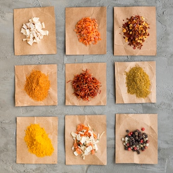Piles of spices on pieces of paper