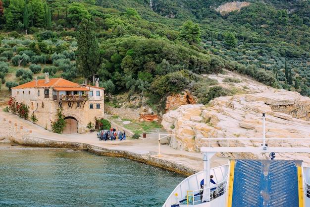 Pilgrims take a ferry to the holy mountain athos