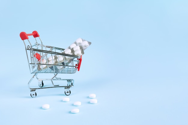 Pill blisters in shopping trolley. pharmacy store concept. buy and shopping medicine concept.