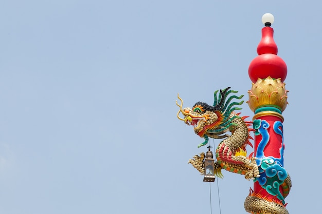 Pillar statue of a dragon.