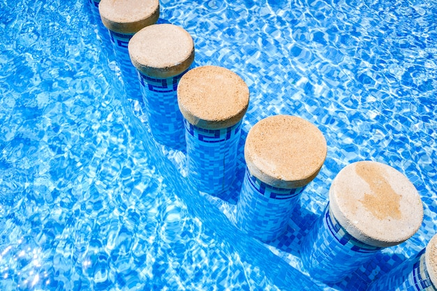 Pillars inside a pool to separate bathing areas.