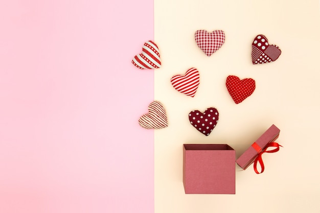 Pillow balloon hearts floating out of the gift box. creative thinking.