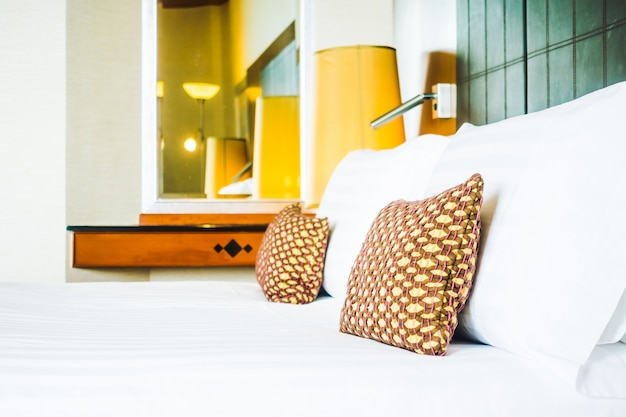 Pillow on bed with light lamp