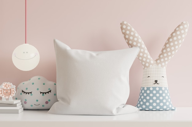Pillow in the children's room on light pink colors wall .3d rendering