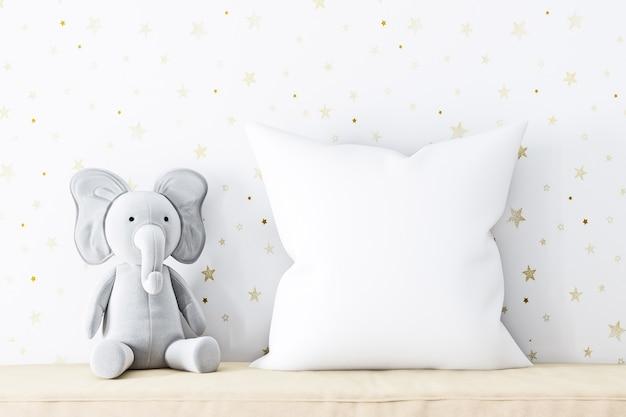 Макет подушки и плюшевый слоненок