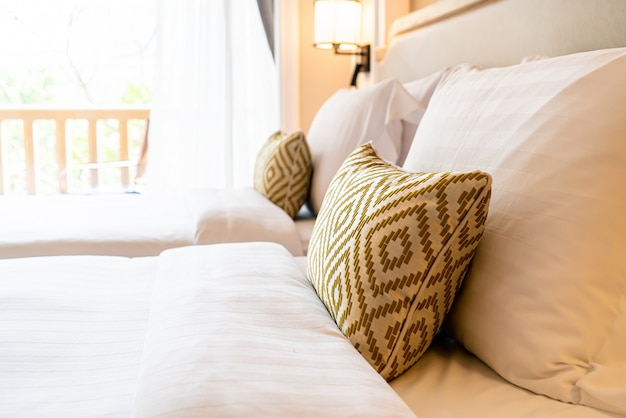 Pillows decoration on bed in hotel bedroom