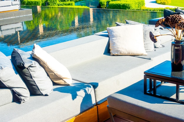 Pillows with outdoor patio deck and sofa on balcony in garden