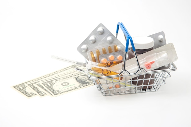 Pills, ampoules and syringe for injection and money on a white background. business and medicine.