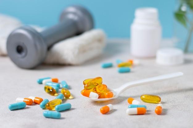 Disposizione di pillole con cucchiaio