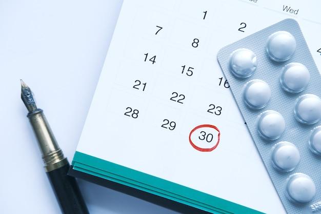 Pills of blister pack on calendar