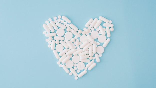 Pills forming heart
