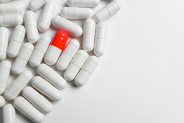 Pills or medications are scattered on a white background. layout for advertising, web background. the concept of medicine, pharmacy and health care. analgesic.