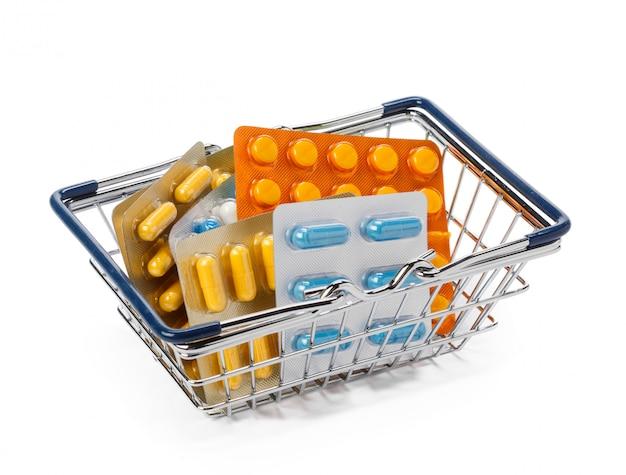 Pills on shopping cart or basket. medical, pharmacy theme concept.