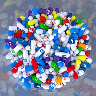 Pills of various types and sizes in a bottle bearing the logo of the most famous social networks