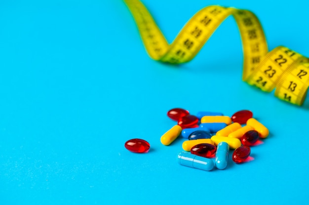 Pills for weight loss and tape measure