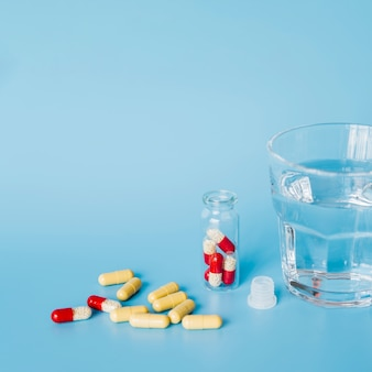 Pills with water glass