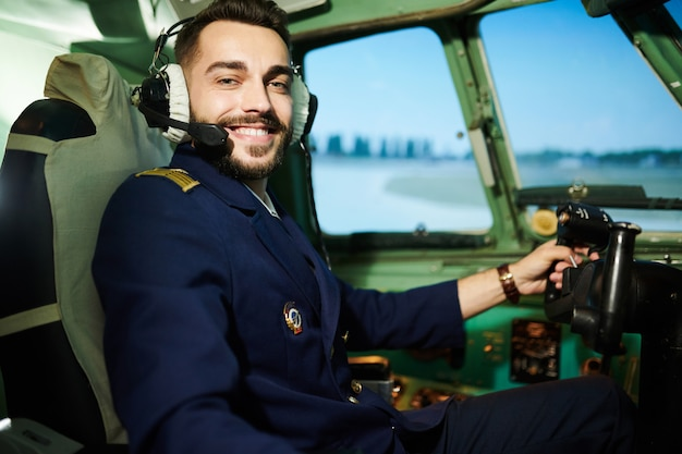 Pilot posing in plane  cabin