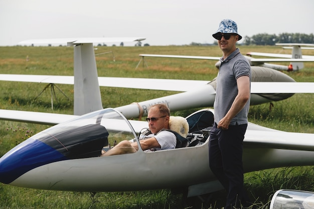 Pilots getting ready for the flight on glider airplane Premium Photo