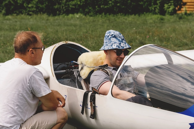 Pilots getting ready for the flight on glider airplane