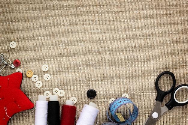Pin cushion with needles, thread