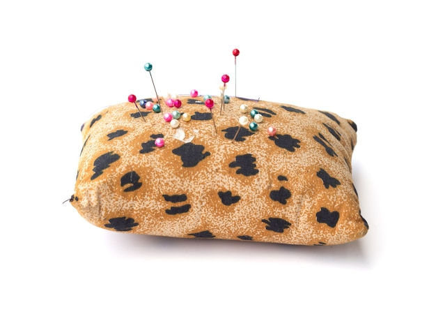 Pin cushion with tiger pattern isolated on white