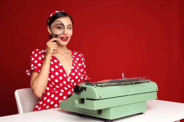 Pin up girl typing on a typewriter