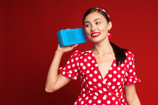 Pin up style girl listening old radio