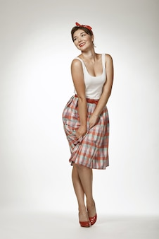 Pin up style portraits on solid background. funny girl posing in retro photo style