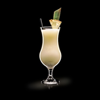 Pina colada - popular drink on a black surface