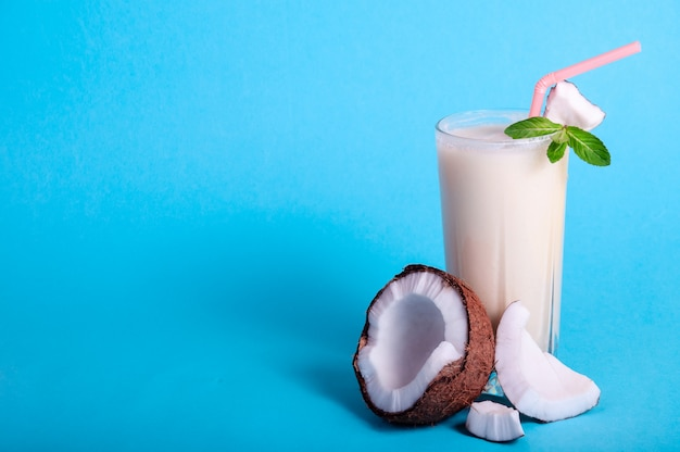 Pina colada - tropical cocktail with pineapple juice, coconut milk and rum. fresh summer drink with cracked coconut and mint