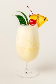 Pina colada with pineapple and cherry on top