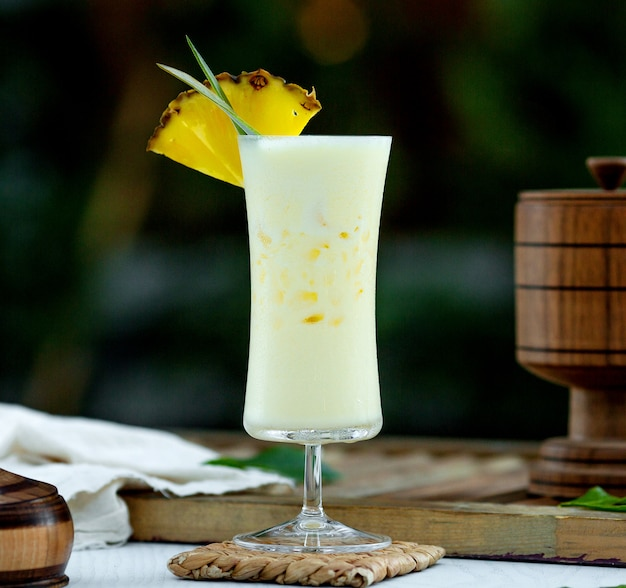 Pinacolada cocktail topped with ananas slice