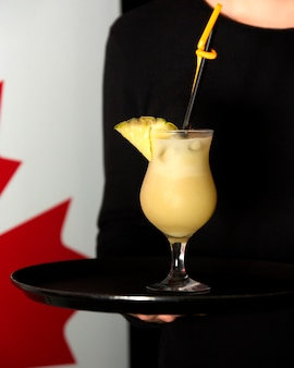 Pinacolada cocktail with ananas slice