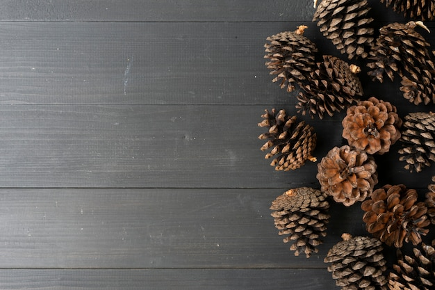 Pine cones on black wooden table background