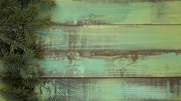 Pine needles on vintage wooden background
