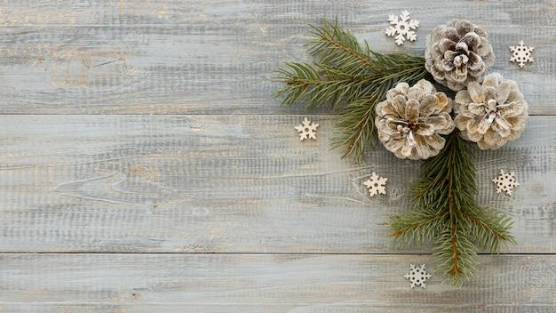 Pine needles on wooden background with conifer cones