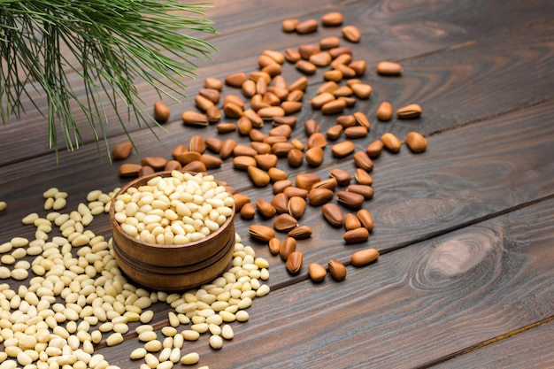 Pine nut kernels in wooden box. pine nuts on table.