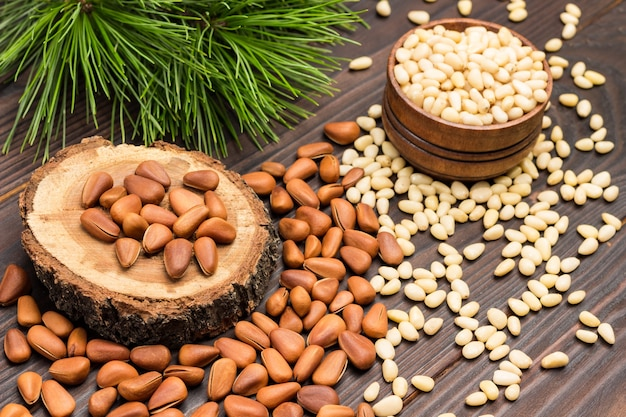Pine nut kernels in wooden box and on table