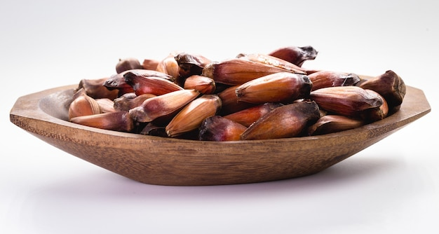 Pine nut seeds on isolated white background. seed of the fruit of the araucaria tree