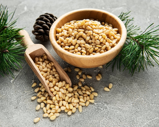 Pine nuts on a grey concrete surface