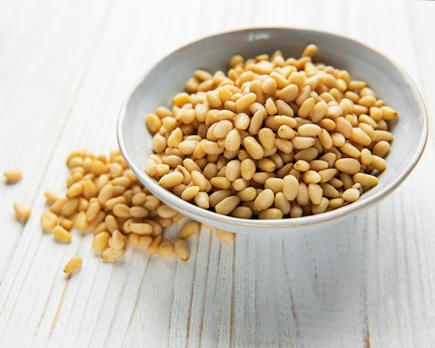 Pine nuts on a old wooden background