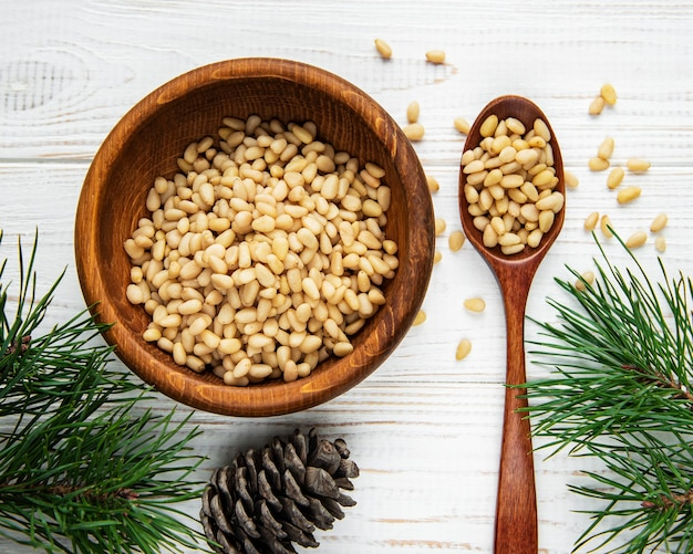 Pine nuts on a old wooden surface
