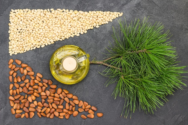 Pine nuts, pine nut oil and cedar branch.